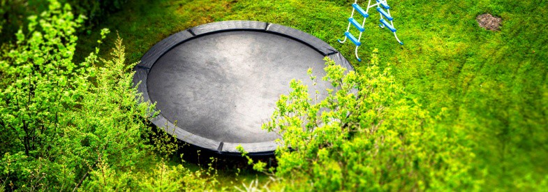 Can You Put a Trampoline on a Sloped Yard How to Do It Safely
